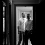 Destination wedding photographer | barcelo maya tropical resort Mexico | wedding photos | Groom entering room black and white
