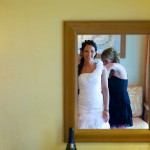 Destination wedding photographer | barcelo maya tropical resort Mexico | wedding photos | brides dress being done up in front of mirror