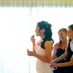 Destination wedding photographer | barcelo maya tropical resort Mexico | wedding photos | bride putting on makeup