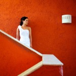 Destination wedding photographer | barcelo maya tropical resort Mexico | wedding photos | bride in front of red wall