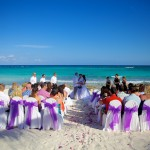 Destination wedding photographer | barcelo maya tropical resort Mexico | wedding photos | Beach wedding ceremony with white and purple chairs