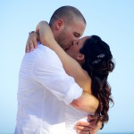Destination wedding photographer | barcelo maya tropical resort Mexico | wedding photos | Bride and groom first kiss on the beach