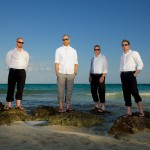 Destination wedding photographer | barcelo maya tropical resort Mexico | wedding photos | Groomsmen on rocks in the ocean