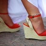 Destination wedding photographer | barcelo maya tropical resort Mexico | wedding photos | Brides wedge shoes red with mothers rosary