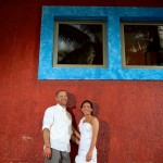 Destination wedding photographer | barcelo maya tropical resort Mexico | wedding photos | bride and groom red wall blue windows