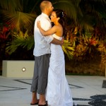 Destination wedding photographer | barcelo maya tropical resort Mexico | wedding photos | Bride and groom dancing in the sunset with palm trees