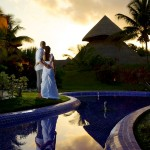 Destination wedding photographer | barcelo maya tropical resort Mexico | wedding photos | bride and groom watch sunset over hut