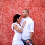Destination wedding photographer | barcelo maya tropical resort Mexico | wedding photos | bride and groom in front of red wall | Groom holding flowers