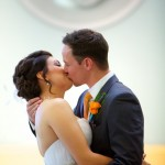 Calgary wedding photographer | Holy spirit catholic church wedding | bride and groom first kiss