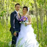 Calgary wedding photographer | Fish Creek Park wedding photos | Bride and groom holding flowers in birch trees