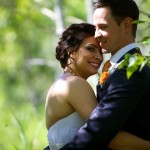 Calgary wedding photographer | Fish Creek Park wedding photos | Bride hugs and snuggles groom in birch trees