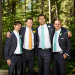 Calgary wedding photographer | Fish Creek Park wedding photos | Groom and groomsmen hanging out in trees
