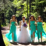Calgary wedding photographer | Fish Creek Park wedding photos | Bride and bridesmaids walking down dirt path in trees
