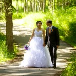 Calgary wedding photographer | Fish Creek Park wedding photos | Bride and groom walking down path in trees