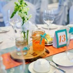 Calgary wedding photographer | Spruce Meadows wedding photos | Orange and teal centre pieces