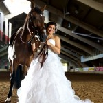 Calgary wedding photographer | Spruce Meadows wedding photos | Bride posing with a horse in a warmup ring