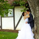 Calgary wedding photographer | Spruce Meadows wedding photos | Bride and groom leaning against a tree kissing passionately