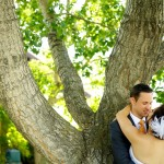Calgary wedding photographer | Spruce Meadows wedding photos | Bride and groom leaning against a tree hugging